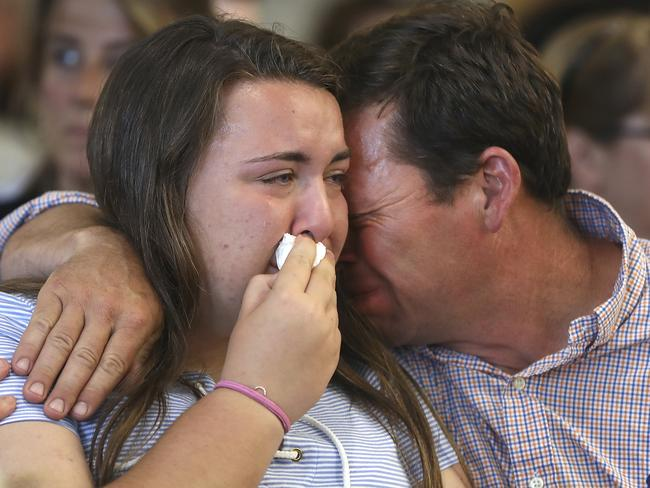 Conrad Roy, Jr, father of Conrad Roy III, comforts his daughter Camdyn Roy in court. Picture: AP Source: AP