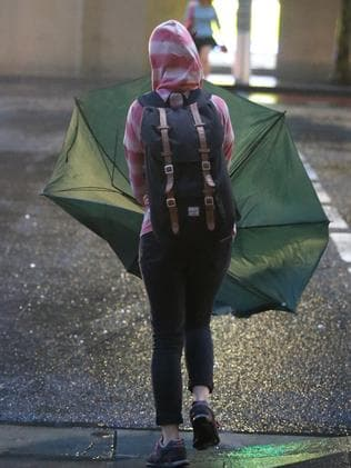 Sydney commuters will have to endure six more days' rain. Picture: John Grainger.