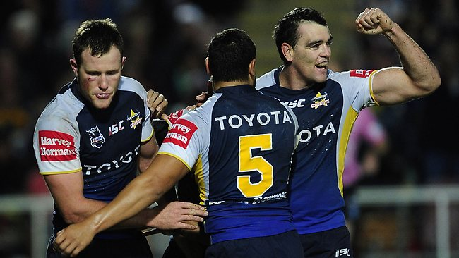 TRY TIME: Cowboys forward Gavin Cooper (left) is congratulated by Antonio Winterstein and Kane Linnett after scoring the opening try of the match. Picture: Ian Hitchcock
