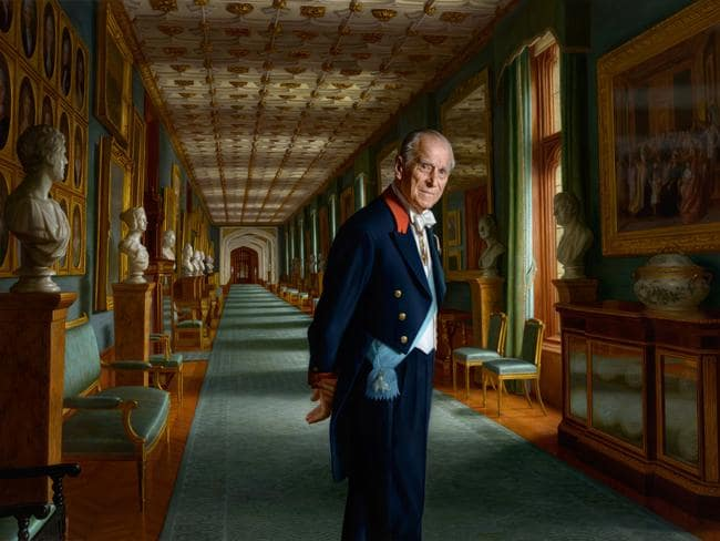 The stunning portrait of Prince Philip, the Duke of Edinburgh by Australian artist Ralph Heimans is set in the Grand Corridor at Windsor Castle. Picture: Ralph Heimans/Buckingham Palace/PA Wire