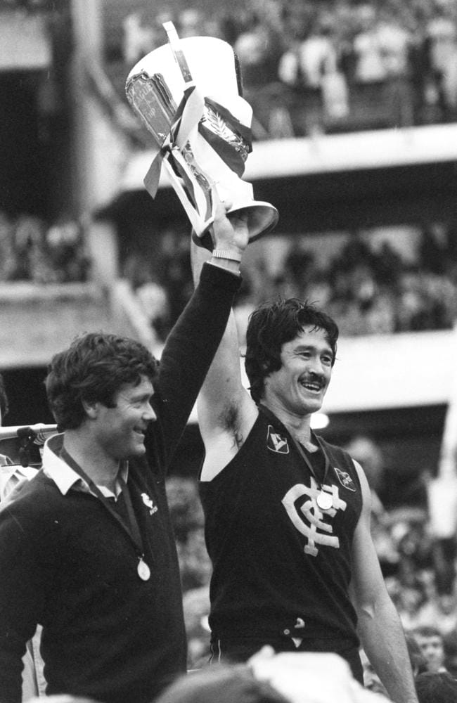 Carlton coach David Parkin and captain Mike Fitzpatrick hold up the 1982 premiership cup.
