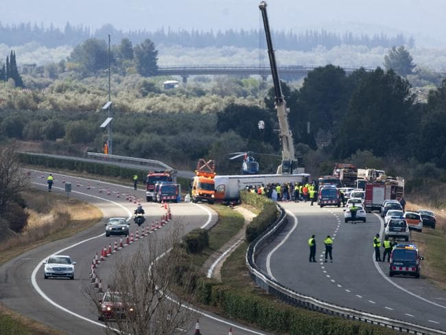 Scene ... the bus crashed on the AP7 highway that links Spain with France along the Mediterranean coast. Picture: AP