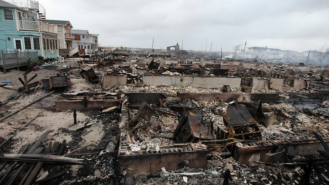 Homes destroyed by a fire at Breezy Point are shown, in the New York City borough of Queens. More than 190 firefighters contained the six-alarm blaze fire. Picture: Frank Franklin II