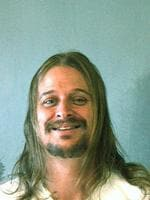 Kid Rock, or Robert J. Ritchie, poses for a mug shot October 21. 2007 in DeKalb County, Georgia. Kid Rock was arrested in the early morning of October 21 after a fight at a Waffle House restaurant in DeKalb County. (Photo by DeKalb County Sheriff's Office via Getty Images)