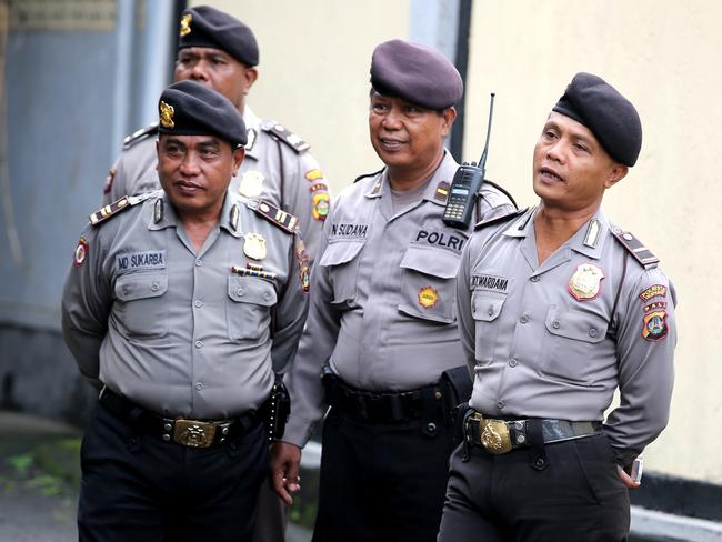 Police officers arrive at the Bali Parole office in Denpasar to prepare for Schapelle Corby to report one last time. Picture: Nathan Edwards.