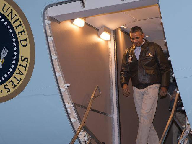 Stepping out ... Obama disembarks Air Force One. Picture: Evan Vucci