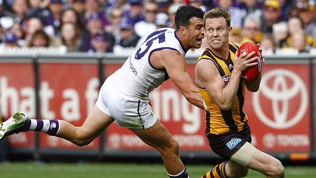 Ryan Crowley of Fremantle and Sam Mitchell of Hawthorn in action. Photo: Michael Klein