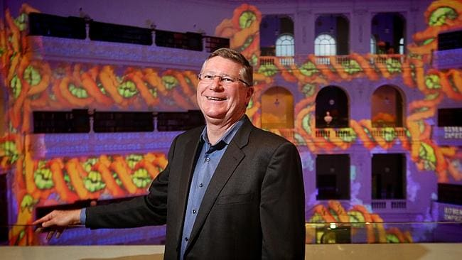 Premier Denis Napthine takes in the 'Molecular Kaleidoscope' at the State Library. Photo: