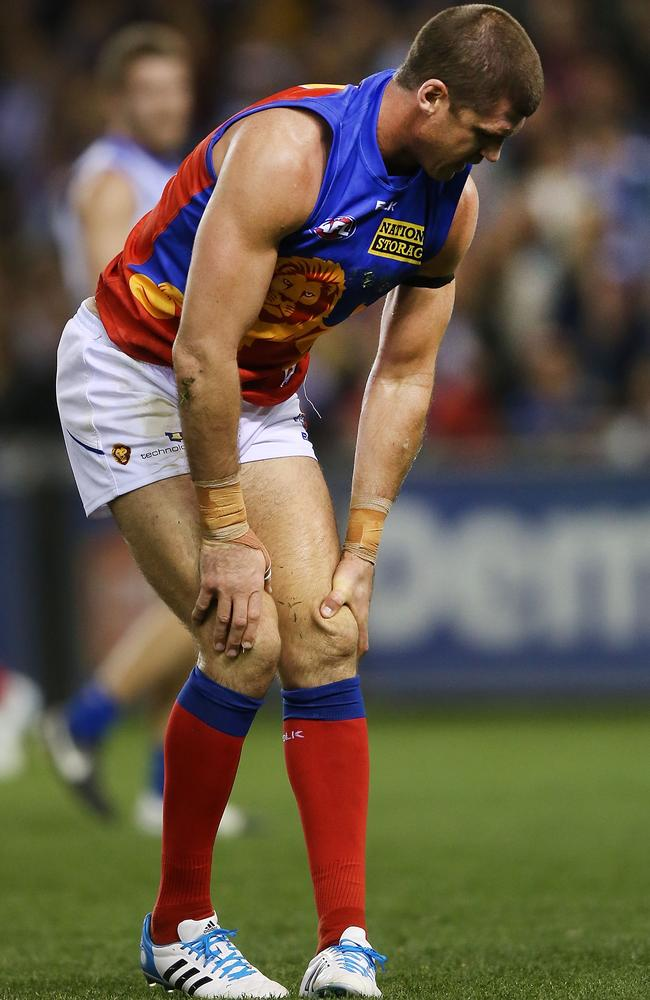 Brown of the Lions hobbles in pain after a contest during the Round 9 thumping against North Melbourne. Photo by Michael Dodge