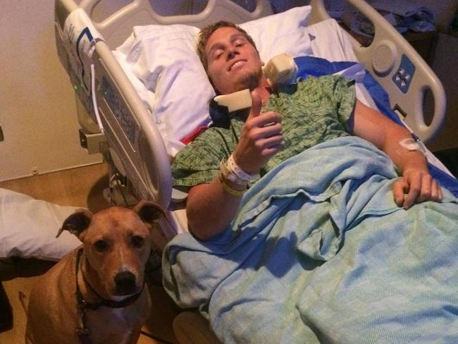 BMX star Sam Willoughby gives a thumbs up from his hospital bed.