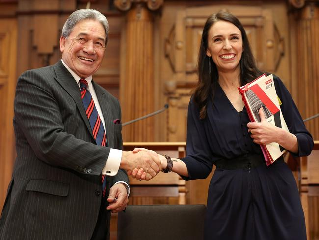 Prime Minister-designate Jacinda Ardern and NZ First leader Winston Peters shake hands. Picture: Hagen Hopkins/Getty Images