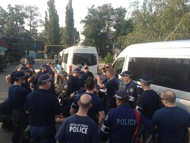 Unacceptable delays ... Australian Federal Police members prepare to leave Soledar in the Ukraine for the MH17 crash site. Picture: Paul Toohey
