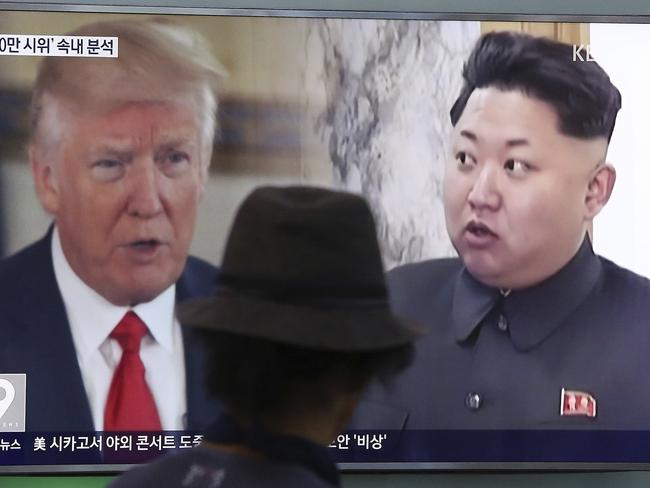A man watches a TV screen showing US President Donald Trump, left, and North Korean leader Kim Jong-un during a news program at the Seoul Train Station in Seoul, South Korea. Picture: AP