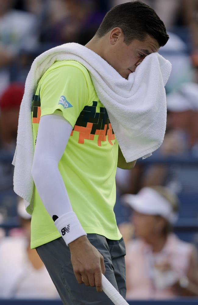 Milos Raonic, of Canada, wipes sweat from his face between points against Peter Gojowczyk.