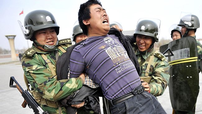 Chinese security forces show off how to quell a riot during a demonstration in Urumqi, China's farwest Xinjiang region on April 1, 2011.