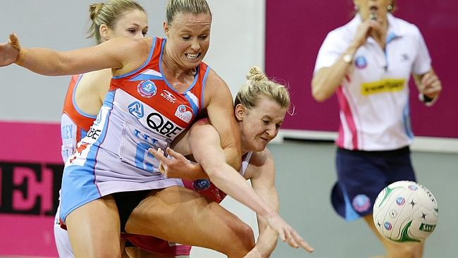 NSW Swifts' Kim Green, left, and Thunderbirds' Kate Shimmin clash. Picture: Sarah Reed.