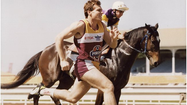 Willie Carne takes on racehorse Jester's Son and jockey Justin Lewis at Eagle Farm.