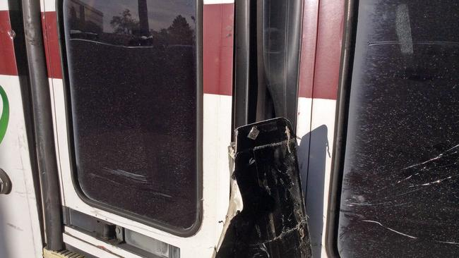 A piece of the to car wound up stuck in the door of the slightly-damaged bus. Picture: Santa Clara Valley Transportation Authority via AP