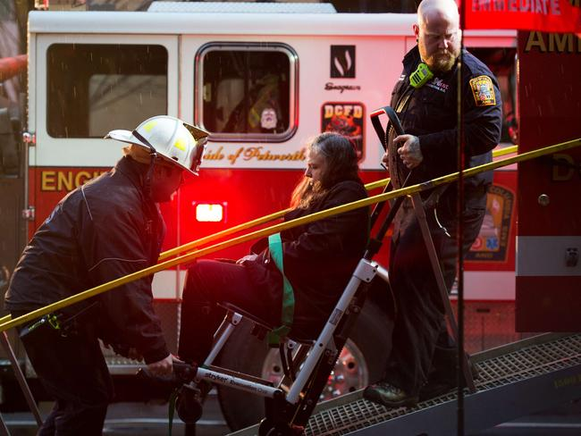 Rescued ... Washington, DC, firefighters load a victim into a medical bus.