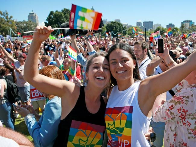 Marriage Equality supporters gather at Prince Alfred Park in Surry Hills ahead of the plebiscite announcement. Tanika Robertson (R) and Hayley Willis are happy with the Yes result. Picture: Toby Zerna