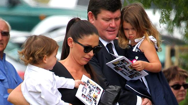 James Packer and his wife Erica arrive with their children Indigo and Jackson at Erica's mothers funeral in Gunnedah, norther...