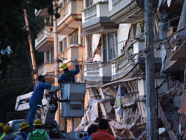 Mexican rescuers search for survivors at a partially collapsed building in Mexico City. Picture: AFP / YURI CORTEZ