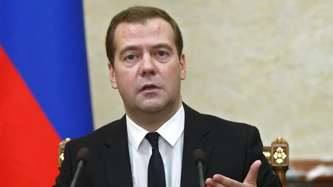 Russian Premier Dmitry Medvedev announces the sanctions at the cabinet meeting in Moscow. Picture: AP Photo/RIA Novosti