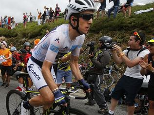Britain's Simon Yates, wearing the best young rider's white jersey, climbs Peyresourde pass during the twelfth stage of the Tour de France cycling race over 214.5 kilometers (133.3 miles) with start in Pau and finish in Peyragudes, France, Thursday, July 13, 2017. (AP Photo/Peter Dejong)