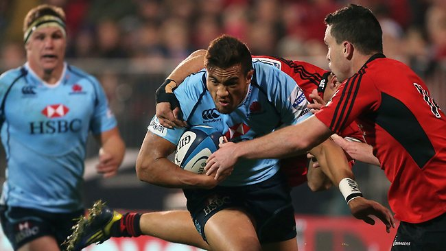 CHRISTCHURCH, NEW ZEALAND - MAY 31: Peter Betham for the Waratahs runs into the defence of Tom Marshall of the Crusaders during the round 16 Super Rugby match between the Crusaders and the Waratahs at AMI Stadium on May 31, 2013 in Christchurch, New Zealand. (Photo by Joseph Johnson/Getty Images)