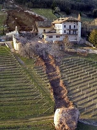 Near miss ... The boulder missed the farm house by less than a metre. Pic: Markus Hell/Tareom.com.