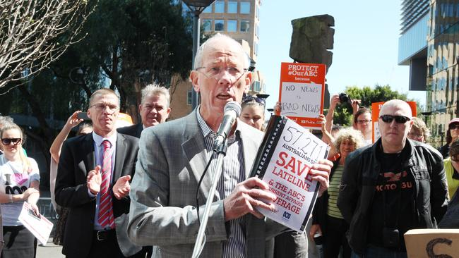 Jonathan Holmes holds up a petition he planned to present to the to ABC Board.