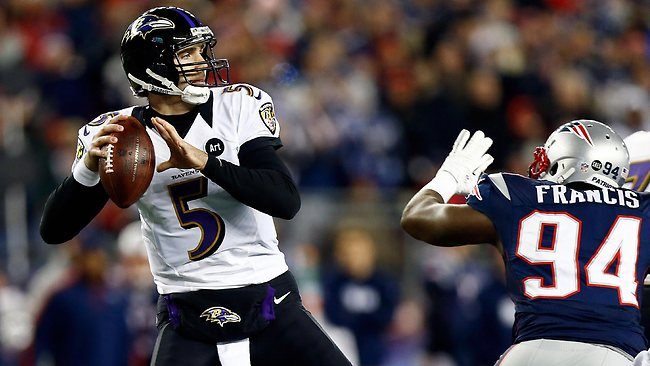 Joe Flacco of the Baltimore Ravens gets pressured by Justin Francis of the New England Patriots.