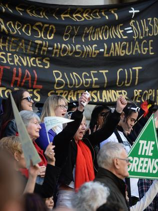 Protesters rally against the Federal Budget on the steps Parliament House in Adelaide. Picture: Naomi Jellicoe