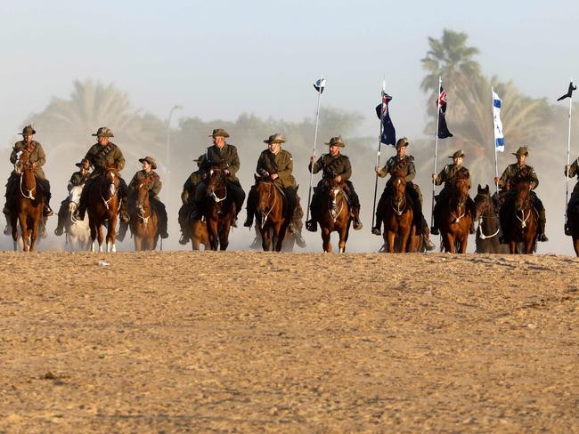 Members of the Australian Light Horse association ride near Beersheva in the southern Israeli desert on October 31, 2017 during a re-enactment of the historical fight of the ANZAC where forces captured the area from the Ottoman Empire during the First World War. Picture: AFP.