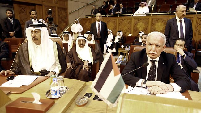 Palestinian foreign minister Riyad al-Malki (R) and Qatari Foreign Minister Hamad bin Jassem bin Jabr al-Thani attend an emergency meeting of the Arab Foreign ministers in Cairo.
