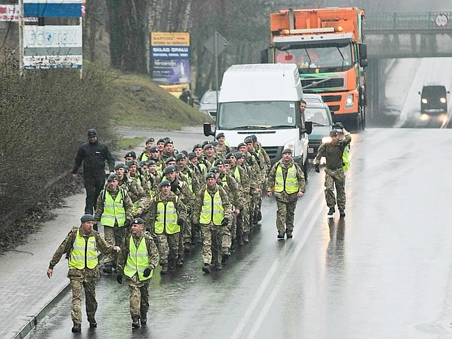 Remembrance ... a group of 50 British air force officers are marching from the site of the Nazi Stalag Luft III prisoner camp near Zagan, Poland to a British war cemetery in western Poland.