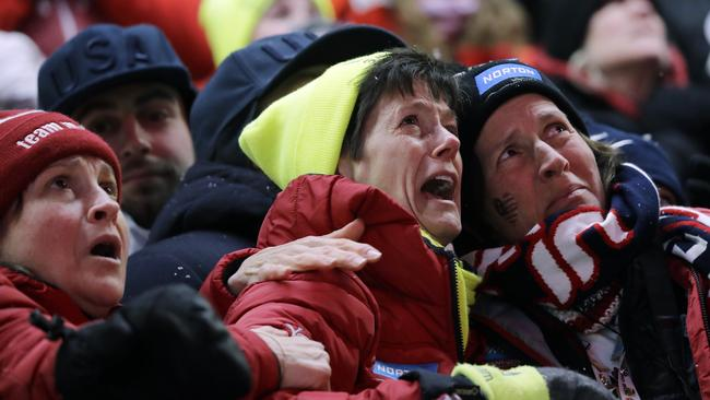 Sue Sweeney, centre, the mother of Emily Sweeney of the United States, cries out as her daughter crashes on the final run during the women's luge final.