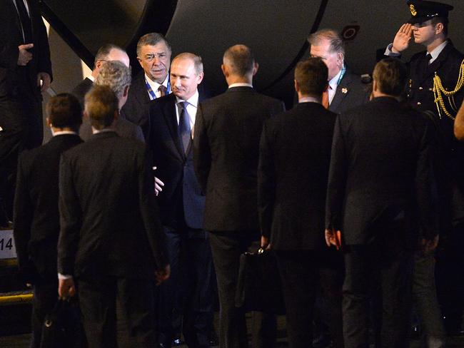 Set for a frosty reception at the G20 summit .... Russian President Vladimir Putin is greeted on arrival at Brisbane. Picture: Bradley Kanaris / Getty Images