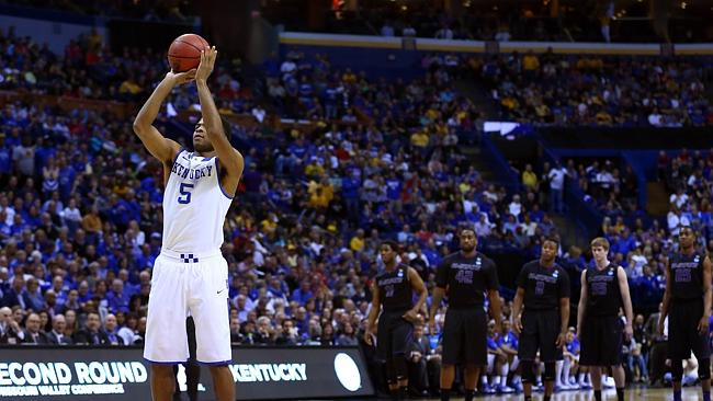 Kentucky's Andrew Harrison takes a free throw after Brian Rohleder of Kansas State received a technical foul during a college basketball warm-up.