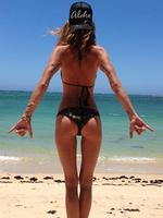 """Texan model Erica Wasson shows off her trim and toned beach bum: """"Live the Aloha"""". Picture: Erin Wasson/Instagram"""