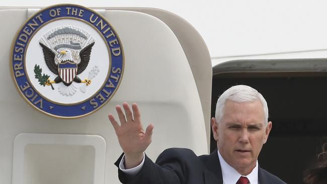 US Vice President Mike Pence waves before leaving for Japan, at Osan Air Base in Pyeongtaek, South Korea, Tuesday, April 18, 2017. Picture: AP Photo/Lee Jin-man