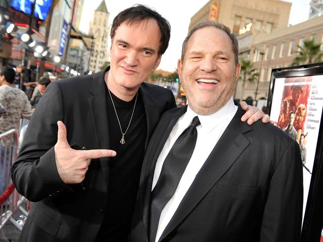 Harvey Weinstein with Quentin Tarantino. The director said in an interview he felt ashamed for not doing more about the mogul's sexual misconduct. Picture: AFP/Getty Images/Kevin Winter
