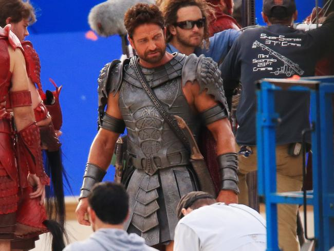 Bad to the bone ... Butler filming  <i>Gods Of Egypt </i>in Sydney's Centennial Park. Picture: Adam Taylor