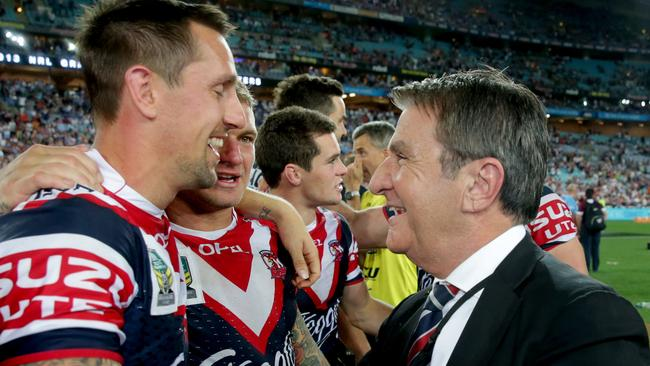 Nick Politis congratulates Mitchell Pearce after the NRL grand final win in 2013.