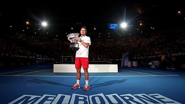 Stanislas Wawrinka of Switzerland poses with the trophy after defeating Rafael Nadal.