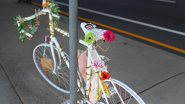 A memorial white bicycle on Gladstone Road in Annerley where a cyclist was recently killed in a road accident Pictures: Jack Tran