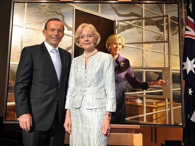 Farewell ... Dame Quentin Bryce with Tony Abbott pose in front of a commissioned painting during a reception at Parliament House in Canberra this week.