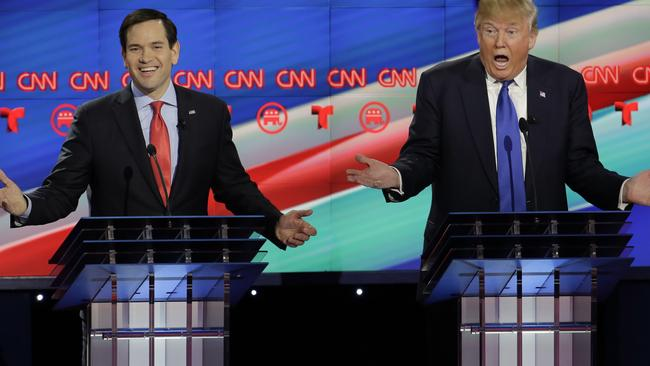 Smiling assassin... Rubio needles Trump during the debate.