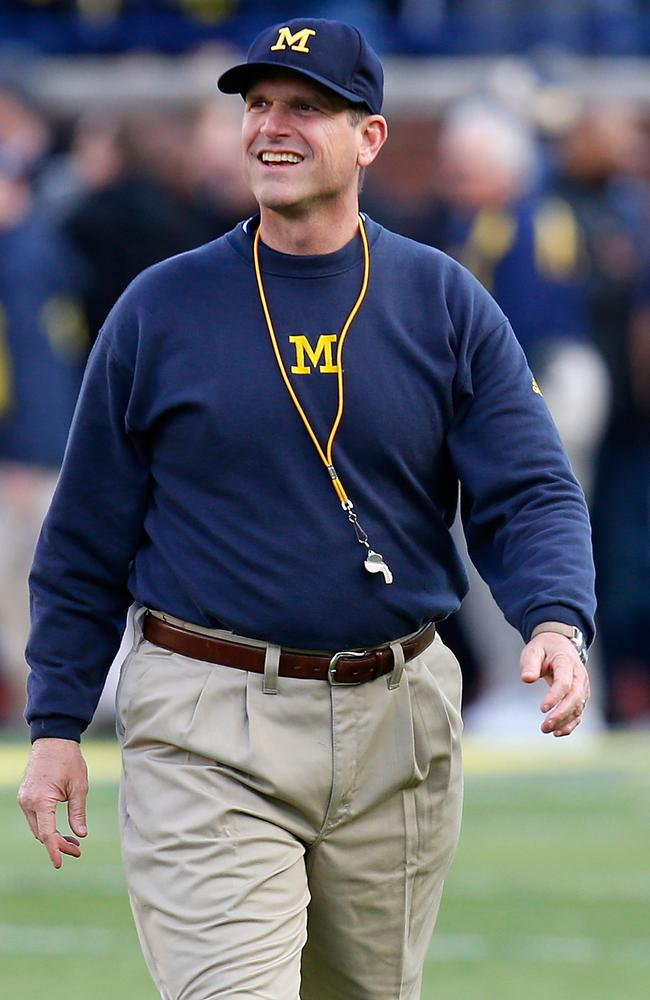 Jim Harbaugh looks on prior to a Michigan Wolverines football game,