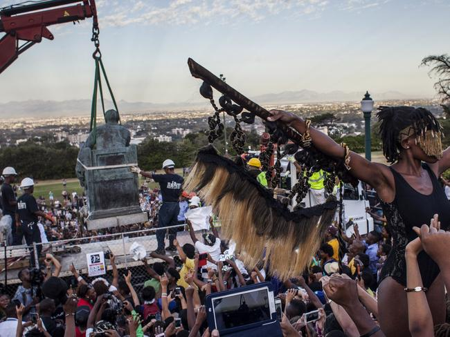 "The statue of British colonialist Cecil John Rhodes was removed from the University of Cape Town as a result of a month long protest by students citing the statue ""great symbolic power"" which glorified someone ""who exploited black labour and stole land from indigenous people"". Picture: Charlie Shoemaker/Getty Images."